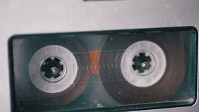 Audio Tape. Vintage Tape Recorder Plays Audio Cassette inserted therein stock video