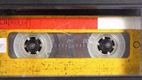 Audio Tape. Vintage Tape Recorder Plays Audio Cassette inserted therein stock footage