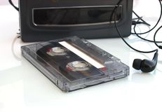 Audio tape and vintage walkman. Casette analogue audio tape and vintange walkman Royalty Free Stock Photography