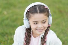 Audio tour headphones gadget. Free style of travelling. Exciting journeys through cities and museums. City guide and. Audio tour. Girl little tourist kid using stock images