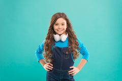 Audio track. Schoolgirl leisure. Online education. Girl adorable child listening audio course. Get more information royalty free stock images