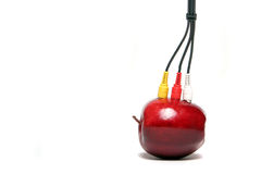 Audio video cables on red apple. 