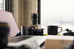 Audio / Video editing workspace office with mountain view. Photography and videography equipment stock image