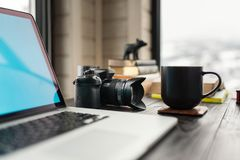 Audio / Video editing workspace office with mountain view. Photography and videography equipment royalty free stock photo