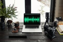 Audio / Video editing workspace office with mountain view. Photography and videography equipment royalty free stock photos