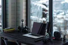 Audio / Video editing workspace office with mountain view. Photography and videography equipment stock photography