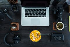 Audio / Video editing workspace office with mountain view. Photography and videography equipment. Videographers healthy breakfast royalty free stock photography