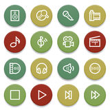 Audio video icons on color buttons. Stock Photos