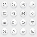 Audio video icons with white buttons on gray backg Royalty Free Stock Image