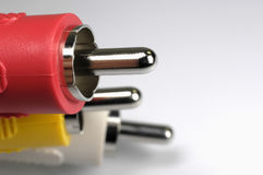 Audio and video plugs. In different colours Stock Photography