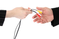 Audio Visual Cables. Business man and woman passing audio visual cables over white background Royalty Free Stock Images
