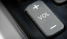 Audio Volume Button on a Plastic Remote Control royalty free stock photo