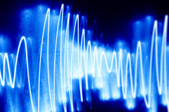 Audio wave. Of lights in blue Stock Image