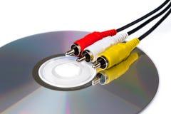 Audio wideo depeszuje na cd, na białym tle Fotografia Royalty Free