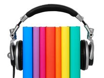Audiobook. Books and headphones on white background stock image