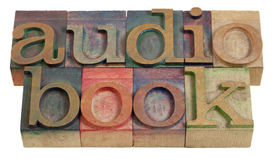 Audiobook. Word in vintage wooden letterpress printing blocks Royalty Free Stock Image