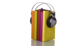 Audiobook. Colorful audiobook concept with headphones and books (isolated on white Royalty Free Stock Photo