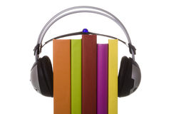 Audiobook. Colorful audiobook concept with headphones and books (isolated on white Royalty Free Stock Photos