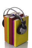 Audiobook. Colorful audiobook concept with headphones and books (isolated on white Stock Photos