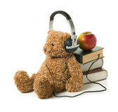 Audiobook for children. Teddybear with headphones on a white background. Concept of audiobook for children Stock Images