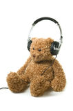Audiobook for children. Teddybear with headphones on a white background. Concept of audiobook for children Stock Photo