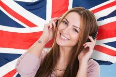Audiobook de écoute d'anglais de femme Image libre de droits