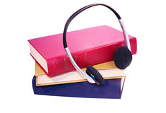 Audiobook. Headphone and stack of books Royalty Free Stock Photography