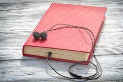 audiobook książkowi pojęcia hełmofony Obrazy Stock