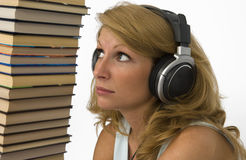 Audiobooks. A woman listens to books. Reading is boring Royalty Free Stock Images