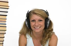 Audiobooks. A woman listens to books. Reading is boring Royalty Free Stock Photography