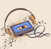 Audiocassette and headphones Royalty Free Stock Photo