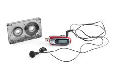 Audiocassette and mp3 player Royalty Free Stock Photo