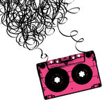 Audiocassette tape with tangled. Royalty Free Stock Photo