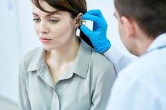 Audiologist Examining Patient royalty-vrije stock foto