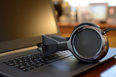 Audiophile Headphones with Laptop PC computer Stock Images