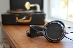 Audiophile Headphones with portable vintage gramophone Victrola Royalty Free Stock Photo