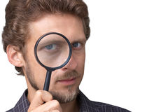Audit. Man with a magnifying glass stock photos