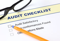 Audit checklist. With ballpoint pen and glasses Stock Image