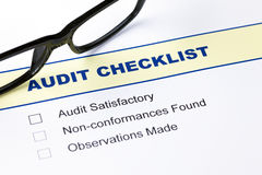 Audit checklist with glasses Stock Image