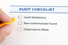 Audit checklist and hand with pencil. Royalty Free Stock Image