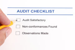 Audit checklist and hand with pencil Stock Image