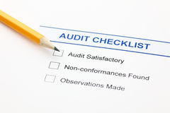 Audit checklist. And pencil. Closeup Stock Photo