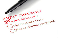 Audit checklist, with tick against on white paper. Stock Photography