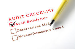 Audit checklist, with tick against on white paper. Royalty Free Stock Photos