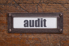 Audit file cabinet  label against rustic wood Stock Images