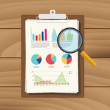 Audit graph data analysis result paper  document finance financial report with magnifying glass Stock Photography