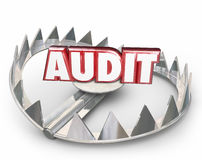 Audit Red 3d Word Steel Bear Trap Danger Warning Tax Review. Audit word in red 3d letters on a steel bear trap to illustrate the danger of a tax review or Stock Image