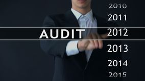 Audit report 2014, businessman finds data in virtual archive financial statement. Stock footage stock footage