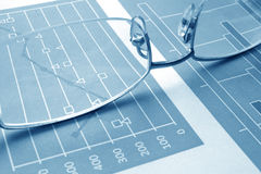 Audit report concept. Glasses on charts with different data. Audit report concept stock photography