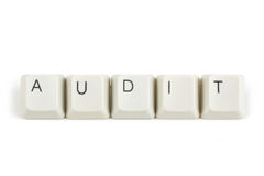 Audit from scattered keyboard keys on white. Audit text from scattered keyboard keys isolated on white background stock image